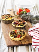 Pepper tartlets on a chopping board