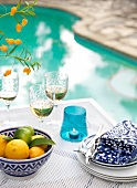 A summery table laid by a swimming pool