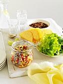 Corn salsa, taco shells, lettuce and chillis