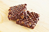 Two fudge brownies with chocolate caramel topping