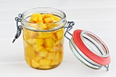 Peach compote in a preserving jar