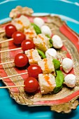 Tomatoes and mozzarella on skewers
