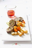 Sliced beef roulade with vegetables