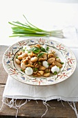 Gnocchi with walnuts, mozzarella, spring onions and basil