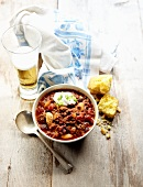 Bowl of Buffalo Chili with Corn Bread and Beer