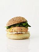 Salmon Burger on a Sesame Seed Bun; White Background
