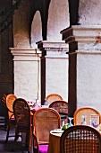 Restaurant Seating Amidst Columns