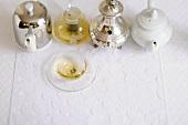 An arrangement of teapots with a tea cup