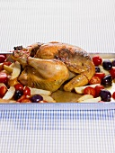 Roast chicken with potatoes, tomatoes and olives
