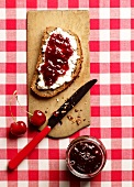 Rustic bread topped with cream cheese and cherry jam