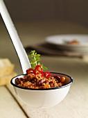 A ladle full of chilli con carne