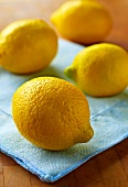 Four Whole Lemons on Blue Linen Napkin