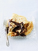 Small Plate of Crepes with Chocolate Sauce