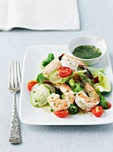 Shrimp Salad on a White Plate with a Small Bowl of Dressing