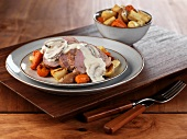Sliced Pork Tenderloin with Mushroom Gravy Over Roasted Root Vegetables