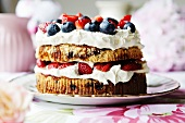 Plate of fruit and cream cake
