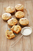 Apple muffins with dried figs and icing sugar