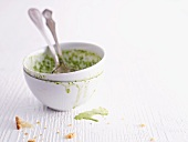 The remains of wild herb soup in a bowl