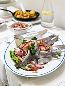 Soused herring with bacon sauce
