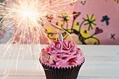 A cupcake with a sparkler