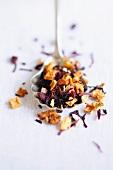 Loose fruit tea on a spoon