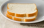 Two Slices of White Bread on a Plate