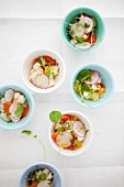 Lobster salad with citrus fruits and radishes in cups