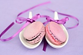Macaroons on spoons tied with ribbons