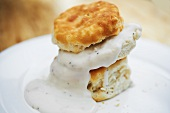 Biscuit and Gravy on a White Plate