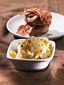 Potato salad with meat balls and bacon