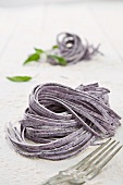 Fresh blueberry tagliatelle on a floured work surface