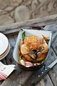 Braised chicken with vegetables in a roasting tin