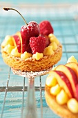 Fruit tartlets with raspberries, cherries and peaches
