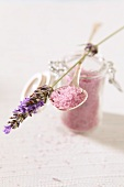 Pink sugar in an open jar with lavender