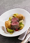 Venison fillets with potato croquettes, Brussels sprouts puree and lingonberries
