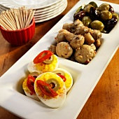 Three Part Serving Dish with Deviled eggs, Marinated Mushrooms and Olives; Bowl of Toothpicks