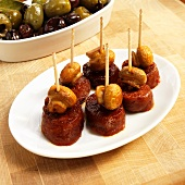 Small Dish of Chorizo and Mushroom Appetizers with Toothpicks