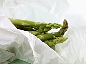 Green asparagus wrapped in paper