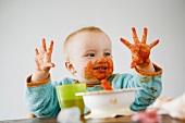 baby full of tomato sauce
