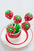 Cake Pops (decorated like strawberries) in a glass