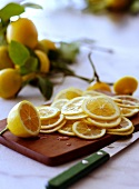 Thinly Sliced Lemons on a Cutting Board