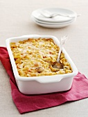 Casserole with macaroni, chicken and mushrooms in a baking dish