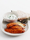 Tandoori fish fillets with mint-yogurt sauce and flat bread