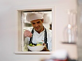 Chef preparing food in restaurant