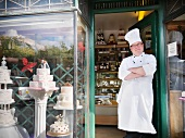 Baker standing in cake shop
