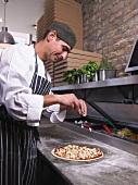 Pizza chef making pizza