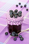 Blueberry jam with fresh blueberries and a spoon