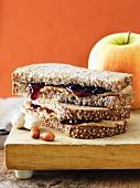 Peanut Butter and Grape Jelly Sandwich on Whole wheat Bread; Halved and Stacked