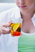 A girl drinking lemon tea