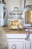 Scones in a storage jar in a kitchen